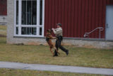 K-9 officer demonstrating his partners ability to take command