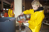 Service employee processing Fall Chinook salmon eggs