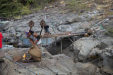 Yakama tribal members using a pulley system to transport salmon