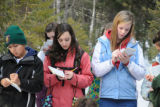 Youth writing in a nature journal