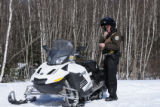 Service Law Enforcement Officer and snowmobile