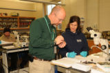 NCTC Fish ID instructor helps a student