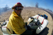 Service employee monitoring prescribed burn
