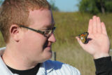 USFWS biologist tags a Monarch butterfly