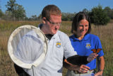 USFWS biologists hold Monarch butterfly