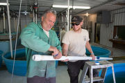 Genoa staff installs plumbing for new sturgeon tanks