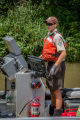 Biologist operates work boat searching for invasive carp