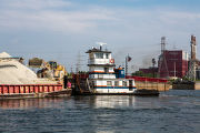 Barge being moved on the Chicago Sanitary and Ship Canal