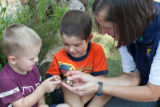 Biologist teaches children about the Monarch butterfly