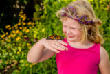 Monarch on little girl's hand