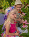 Children look at monarch on flower