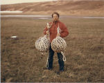 Matthew H. Dick holding Japanese fishing floats