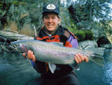 Man holding a Rainbow trout