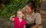 Little girl shows monarch to fws employee