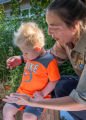 FWS employee shows child a monarch