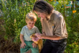 FWS employee explains to child on tagging a monarch