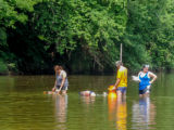 Students laying underwater transects
