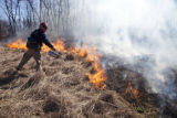 Firefighter torching grass