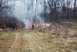 Firefighters gather around small burn area