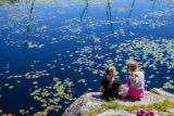 Girls enjoying a frog pond
