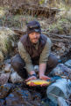 Biologist holds Gila trout in Mineral Creek