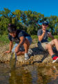 Two boys fishing for small mouth bass