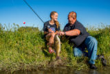 Girl with father with smallmouth bass