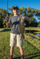 Boy with smallmouth bass