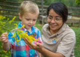 Child and FWS biologist with monarch butterfly