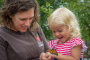 Mother and daughter with monarch butterfly