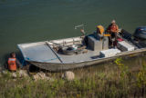 Biologists standing at boat on the Missouri River