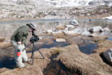Videographer films biologists
