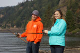 Young couple fishing for Fall Salmon