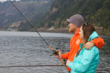 Young couple fishes for Fall Salmon