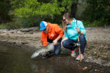 Young couple releases a Fall Salmon