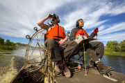 Employees maneauver an airboat at Bayou Sauvage NWR
