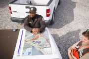 Employee with map of the refuge