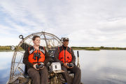 Employees operate an airboat at Bayou Sauvage NWR
