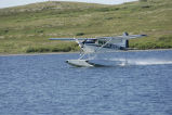 Float Plane Landing on Lake
