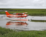 Floatplane taxing down Kashunuk River