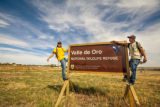 Youth on sign at Valle de Oro
