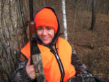Youth deer hunter in treestand