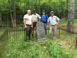 Employees pose by historic grave site at Horicon National Wildlife Refuge