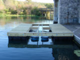 Floating upweller system with floating dock and trash can culture chambers