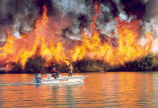 Prescribed fire ignited by boat