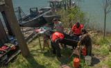 USFWS Fisheries crew prepares to operate on lake sturgeon