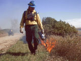r6-nd-usr-firefighter applies fire to burn