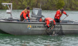 USFWS Fisheries crew in boat capturing lake sturgeon