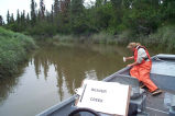 Julie Laker Collects a Water Sample from Beaver Creek