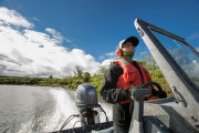 Biologist pilots boat on the Andreafsky River